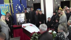 Ukrainians Mourn Slain Activist Targeted In Acid Attack