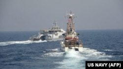 The Iranian Harth 55 (left) conducted an unsafe and unprofessional action by crossing the bow of the Coast Guard patrol boat USCGC Monomoy (right) as the U.S. vessel was conducting a routine maritime security patrol in international waters of the southern Arabian Gulf on April 2, the U.S. Navy said.