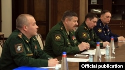 Armenia -- Colonel-General Sergei Istrakov (second from left), the deputy chief of the Russian military's General Staff, meets with Armenian Defense Minister Vagharshak Harutiunian, Yerevan, January 29, 2021.