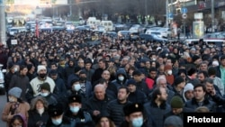Armenian opposition groups take part in a protest march in Yerevan on February 22.