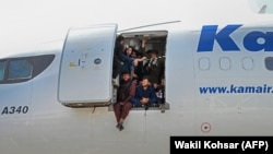 Desperate Afghans cram into a plane at the airport in Kabul in a bid to flee the country on August 16. (file photo)
