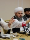 Representatives of the Taliban attend a news conference in Moscow on July 9