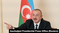 AZERBAIJAN -- Azerbaijani President Ilham Aliyev gestures as he speaks during an address to the nation in Baku, October 26, 2020