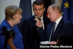 Conferință de presă comună alături de președinții rus și francez, Vladimir Putin și Emmanuel Macron, după un summit în formatul Normandia - Paris, 10 decembrie 2019