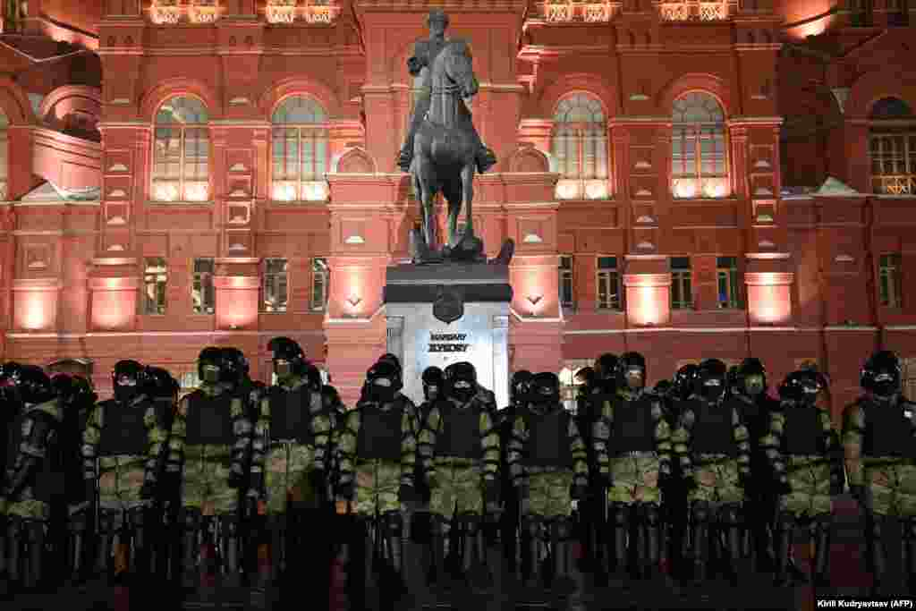 Security forces stand guard in front of a monument to Soviet Marshal Georgy Zhukov outside Red Square in Moscow.