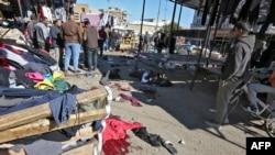 21-уми январ. Саҳнаи ду таркиши пурқурбонӣ дар бозоре воқеъ дар маркази шаҳри Бағдод