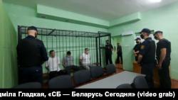 Дзьмітры Папоў, Уладзімер Цыгановіч, Сяргей Ціханоўскі на лаве падсудных