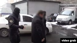Armenia -- A screenshot of a National Security Service vide of the arrest of defense contractor Davit Galstian, February 1, 2021