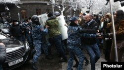 Armenia -- Riot police clash with opposition protesters outside the main Armenian government building in Yerevan, December 24, 2020.