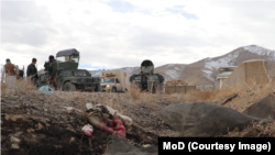 The aftermath of an attack on an Afghan Army base in the southeastern city of Ghazni this week.