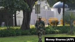 FILE: A Border Security Force (BSF) soldier stands guard outside the Pakistani embassy in New Delhi.