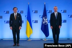 Ukrainian Foreign Minister Dmytro Kuleba (left) and NATO Secretary-General Jens Stoltenberg prior to a meeting at NATO headquarters in Brussels on April 13