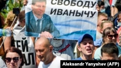 """People carry a banner reading """"Freedom for Furgal!"""", during a rally in support of the ex-governor in Khabarovsk on July 18."""