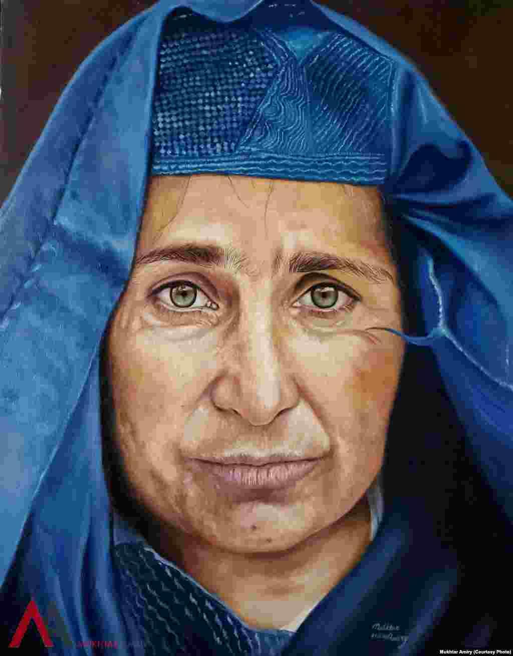 زن افغان در چادری