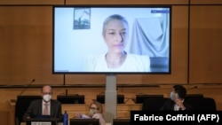 UN envoy Anais Marin is seen speaking via video link before a meeting of the United Nations Human Rights Council on allegations of torture and other serious violations in Belarus in September 2020.