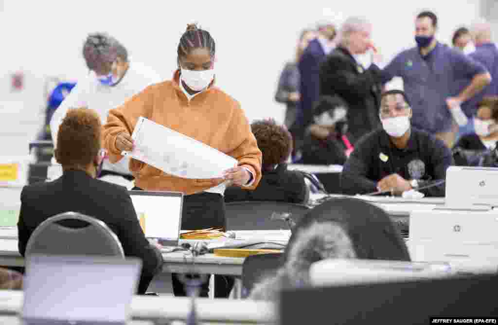 Absentee Ballots are certified and then counted at TCF Center, in Detroit, Michigan, USA, 04 November 2020.