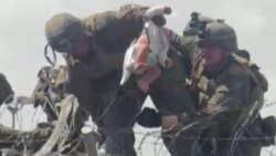 Desperate Afghans Hand Babies To Soldiers At Kabul Airport
