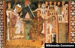 """Szilveszter római püspök és Nagy Konstantin egy 13. századi római képen. Az ábrázolás utólagos történelemhamisítási kísérlet, hiszen Konstantin császár biztosan nem hódolt be a római püspöknek, pont, hogy önmagát tartotta """"a keresztény alattvalók legfőbb püspökének""""."""