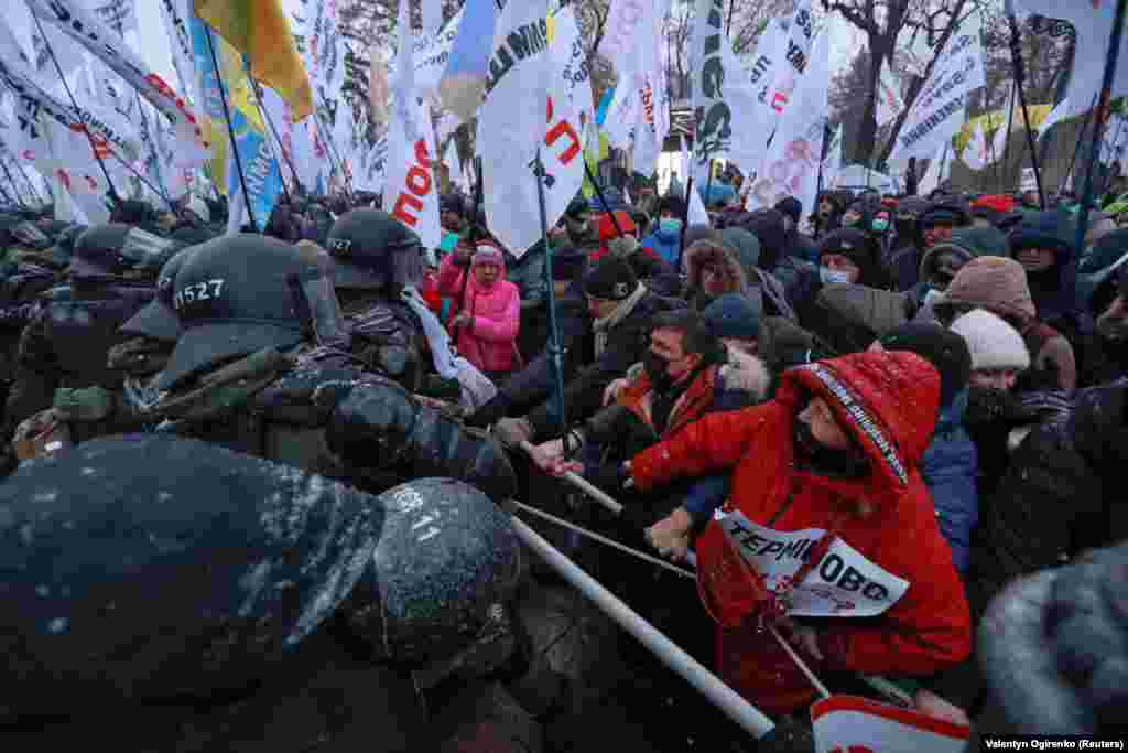 Ukrainian law enforcement officers block demonstrators during a rally held by entrepreneurs and representatives of small businesses near the parliament building amid the COVID-19 outbreak in Kyiv on November 17. (Reuters/Valentyn Ogirenko)