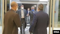 IAEA Director-General Rafael Grossi (in blue mask) arrives at Tehran's airport on September 11.