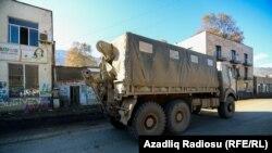 NAGORNO-KARABAKH -- An Azeri military truck drives drives along a street in Hadrut town, November 25, 2020