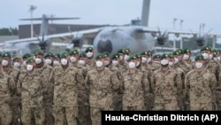 German soldiers line up for a final roll call after returning from Afghanistan at the airfield in Wunstorf, Germany, on June 30.