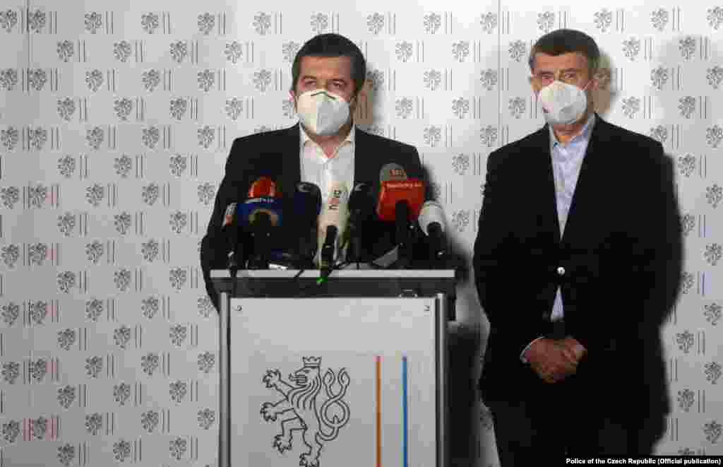 Czech Prime Minister Andrej Babis (right) and Interior Minister and acting Foreign Minister Jan Hamacek talk to reporters at an emergency press conference late on April 17. Babis blamed the blasts on the Russian military intelligence agency known as the GRU, and specifically on a secretive unit known as Unit 29155.