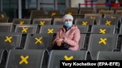 RUSSIA -- A passenger waits at a coronavirus testing station at the Vnukovo airport in Moscow, October 8, 2020