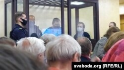 The three defendants appear in court in Hrodna on May 17.