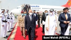 President Mohammad Ashraf Ghani arrives in Qatar on October 5.