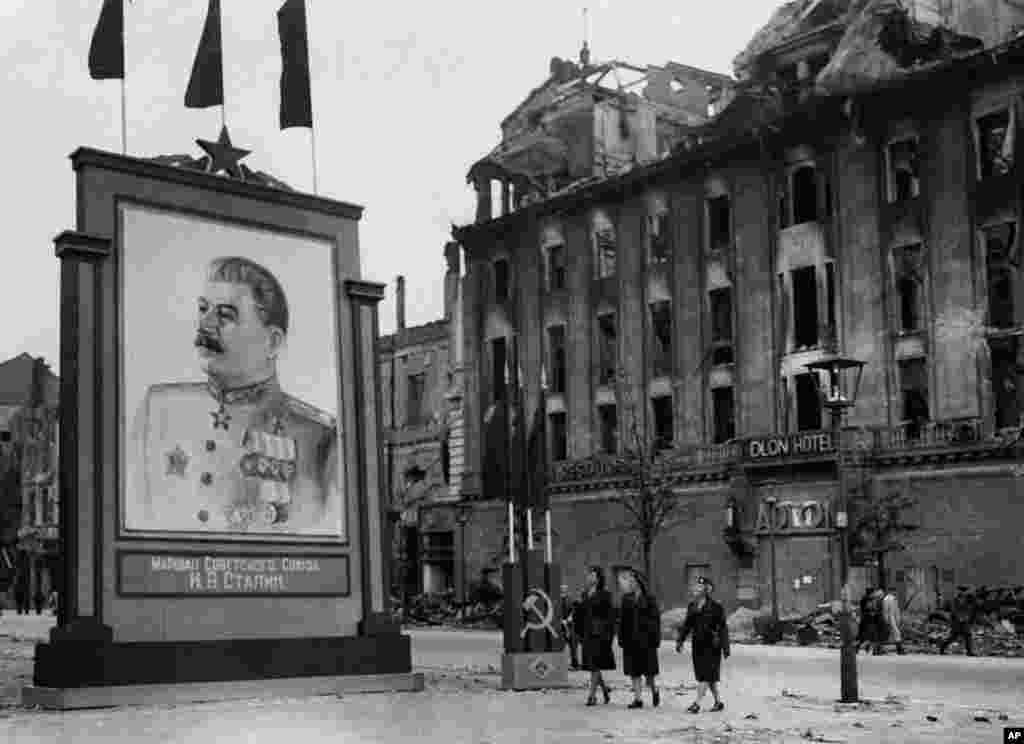 A portrait of Soviet leader Josef Stalin hangs in central Berlin in the summer of 1945.
