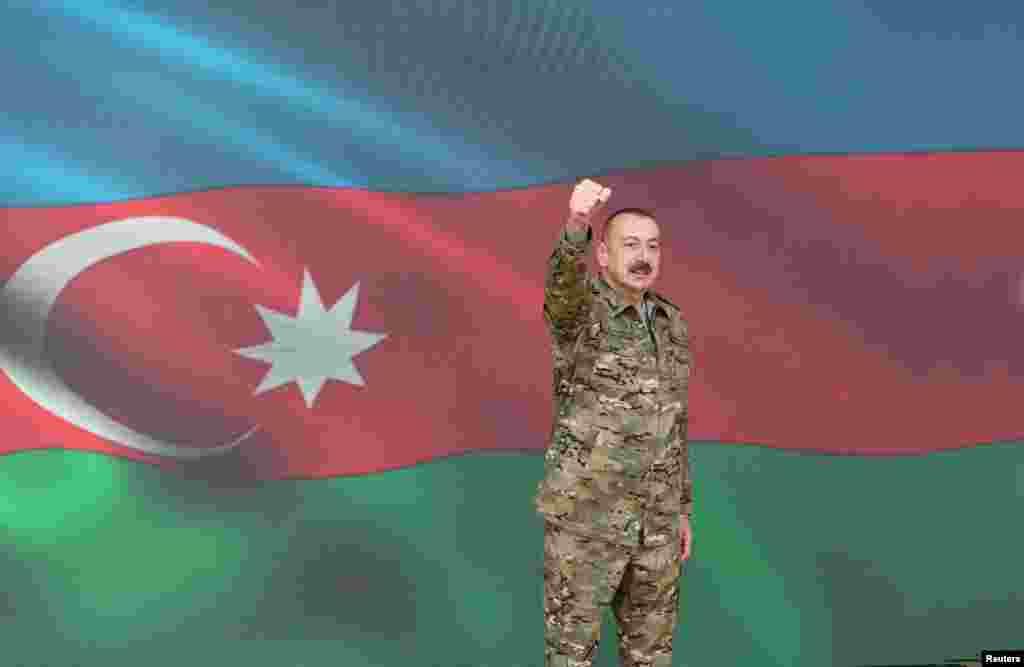 Azerbaijani President Ilham Aliyev gestures as he makes a televised address on November 8 announcing the capture of Shushi/Susa.