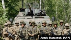 "Militari polonezi și americani la manevrele "" Defender-Europe 20"" de la Drawsko Pomorskie, 17 iunie 2020."