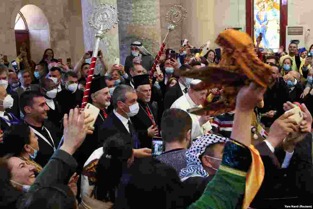 Pope Francis arrives to hold a prayer at the Grand Immaculate Church in the town of Qaraqosh, Iraq, March 7, 2021.
