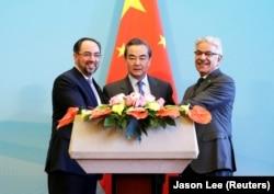 Afghan Foreign Minister Salahuddin Rabbani, Chinese Foreign Minister Wang Yi, and Pakistani Foreign Minister Khawaja Asif in 2017.