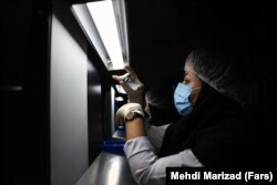 A medical technician works on the production line of Iran's COVIran Barekat vaccine.