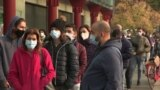 People are seen on the streets of Italy wearing masks.