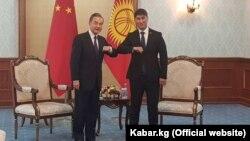 Ван И и Чингиз Айдарбеков.