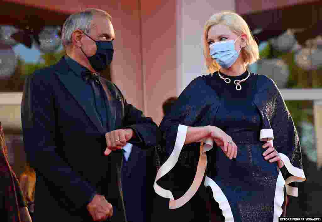 Film Festival director Alberto Barbera (Left) and President of the 'Venezia 77' jury Australian actress Cate Blanchet arrive for the opening ceremony and screening of 'Lacci' at the 77th annual Venice International Film Festival, in Venice, Italy, 02 September 2020.