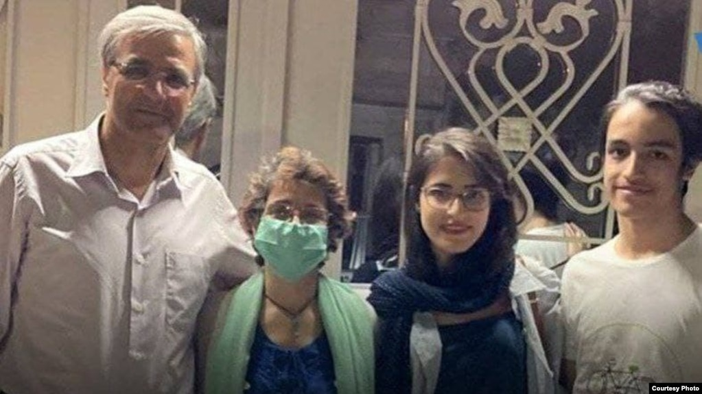 Nasrin Sotoudeh (masked) poses with her husband and children after her release from prison on July 21.