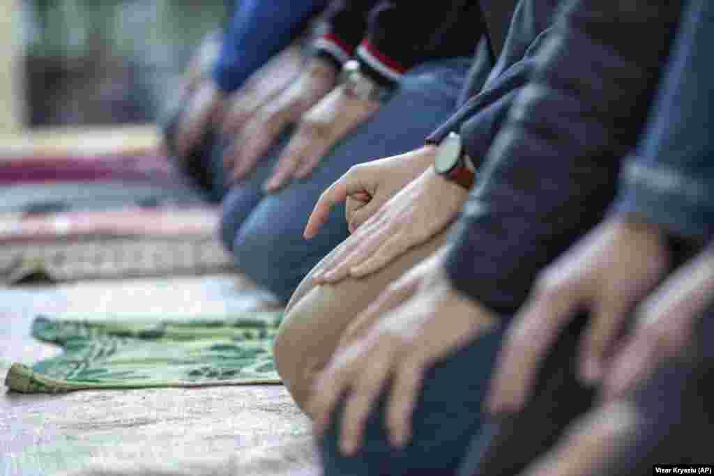 Kosovar men attend Eid al-Fitr prayers outside a mosque in the capital, Pristina.