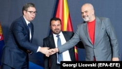 Serbian President Aleksandar Vucic (left), North Macedonia's prime minister, Zoran Zaev (center), and Albanian Prime Minister Edi Rama pose for photographers after signing documents during the Skopje Economic Forum on Regional Cooperation on July 29.