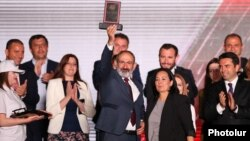 Armenia - Former Prime Minister Nikol Pashinian and senior members of his Civil Contract Party celebrate their election victory at a rally in Yerevan, June 21, 2021.