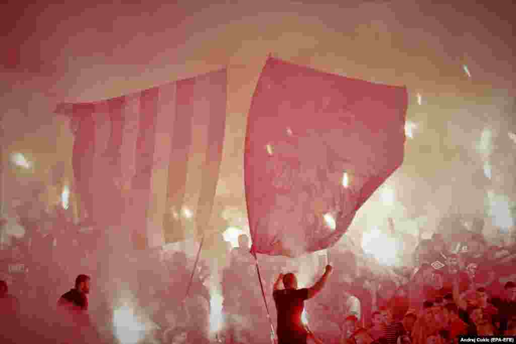 Supporters of the soccer club Red Star Belgrade light flares during a game against archrivals Partizan on September 19.