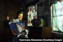 Abau a Kuzbassz volt kormányzójának, az Egységes Oroszország kormánypárthoz tartozó Aman Tulejevnek a választási plakátjával