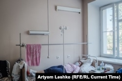 Tatyana rests in her hospital bed.