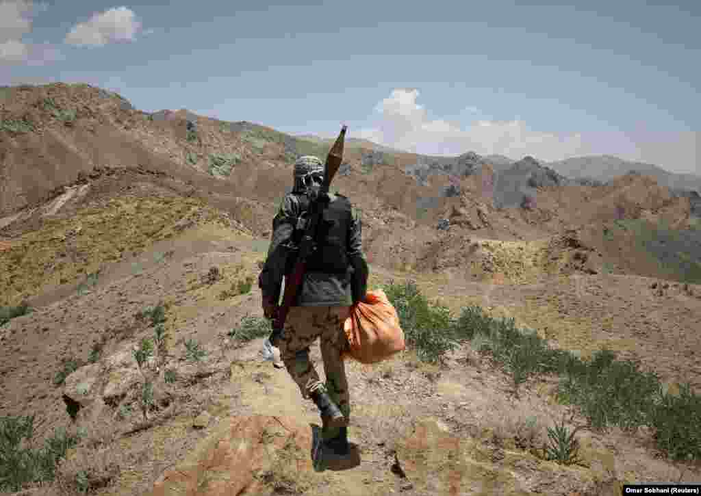 An anti-Taliban fighter walks near a check post in the Ghorband district of Afghanistan's Parwan Province.