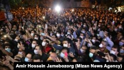 Fans of Iranian singer Mohammad Reza Shajarian gather in front of Jam Hospital after his death on October 8.