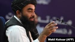 Taliban spokesman Zabihullah Mujahid speaks during a press conference in Kabul on September 6.
