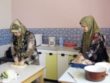 Uzbekistan/Czech Republic - Uzbek refugees from Andijon Momina (R) and Odina (L) preparing lunch at a refugee camp in Straz pod Ralskem, 5May2006